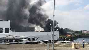 Queen Mary: Smoke could be seen around the local area.