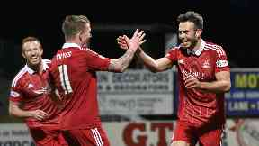 Aberdeen's Andy Considine (right) celebrates with Jonny Hayes against Dundee in March.
