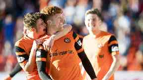 Simon Murray celebrates Dundee United's lead with his team mates.