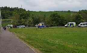 Questioned: Police were called to an incident near a park in Hallglen
