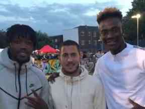 Eden Hazard (centre) poses with Nathaniel Chalobah (left) and Tammy Abraham.