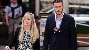 Charlie's parents outside the Royal Courts of Justice in London