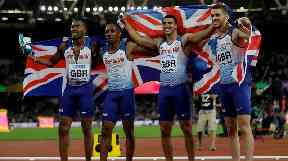 Team GB celebrate their gold at the 4x110m men's relay.