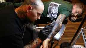 Graeme getting his lion tattoo.