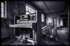 A piano sits among the rubble.