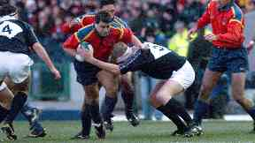 Tackle: Weir in action for Scotland.