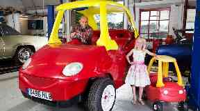 Geof Bitmead and his granddaughter Lili with the largest crazy coupe.