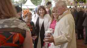Prince Charles met people from local community groups at the garden party to celebrate 10 years since the house was saved.