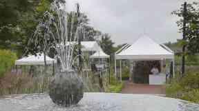 Rain failed to dampen the spirits of the garden party.