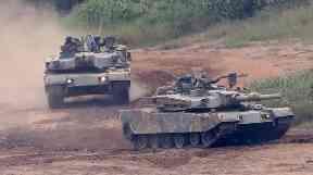 South Korean K-1 tanks move during a military exercise in Paju, South Korea.