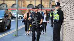Armed police were stationed outside the venue