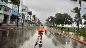 A skateboarder braves the rains in Florida as Irma makes her presence known.