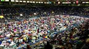 Evacuees fill Germain Arena, which is being used as a fallout shelter.