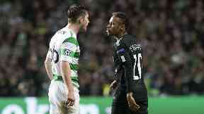 Anthony Ralston and Neymar clash in the Champions League.