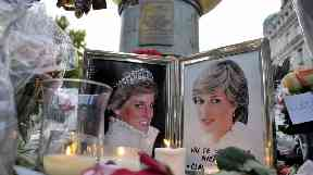 Flowers and photos of Diana on the plinth of the Flame of Liberty statue in Paris.