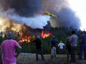 Firefighters have been battling fires like this one in Macao, central Portugal