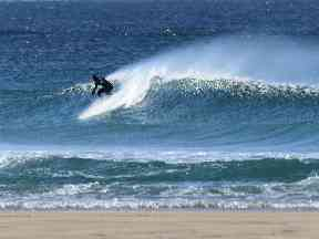 Surfers on Lewis take to the waves.