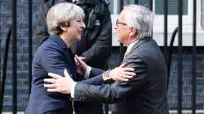 Mr Juncker denied that he said Mrs May 'begged for help'.
