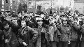 Factory workers wave copies of Mao Zedong's Little Red Book in 1967.