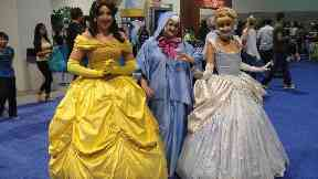 Belle is joined by Cinderella and her fairy godmother.