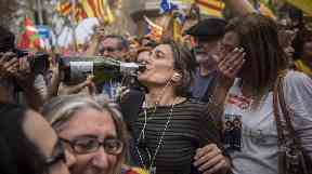 Pro-independence supporters partied on the streets of Barcelona before Madrid imposed direct rule.
