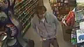 CCTV: Footage was released of Mr Ritchie in a shop.