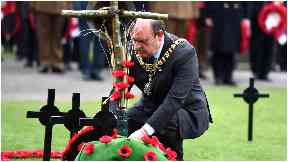 Frank Ross lays wreath.