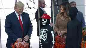 Donald Trump and Melania Trump meet a 'trick or treater'.