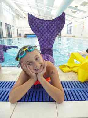 Mini mermaids learn how to dolphin kick and wear special monofins to swim in.