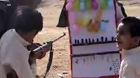 Children learning to fire a gun inside bin Laden's compound.