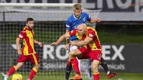 Rangers' Ross McCrorie vies with Partick Thistle forward Connor Sammon for possession.