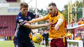 Ross County defender Marcus Fraser challenges Motherwell forward Louis Moult.