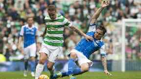 St Johnstone's Paul Paton tackles Celtic forward Leigh Griffiths.