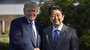 Mr Trump with counterpart Shinzo Abe.