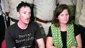 Escape: Matthew Kidd and Jessica Gray with police after ordeal.