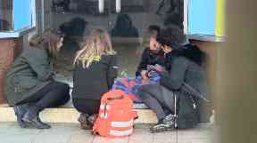 Volunteers check on a homeless person in Hull.