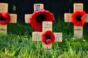 Wooden crosses with knitted poppies help to raise money for the cause.