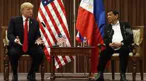 Donald Trump pictured with Philippines President Rodrigo Duterte