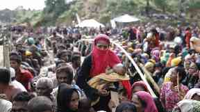 Rohingya refugees wait for aid in a camp in Bangladesh.