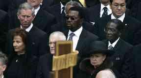 Robert Mugabe seated near Prince Charles at Pope John Paul II's funeral.