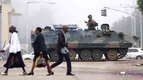 Army troops and armored vehicles remain on the streets of Harare.