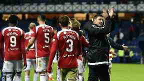 Martin Canning applauds the travelling fans at full time.