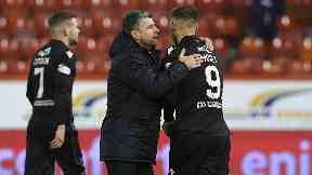 Stephen Robinson and Louis Moult at full time at Pittodrie.