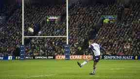 Scotland's Finn Russell converts a kick against New Zealand at Murrayfield.