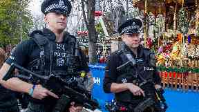 Edinburgh: Armed police on patrol at Christmas market.