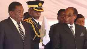 Emmerson Mnangagwa (left) and Robert Mugabe at a gathering in early November.