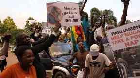 Zimbabweans celebrate Robert Mugabe's resignation in Harare.