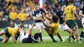 Finn Russell: The back evades a challenge as Scotland beat Australia 24-19 in Sydney.