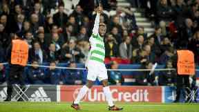 Moussa Dembele celebrates his opener against Paris Saint-Germain on Wednesday.