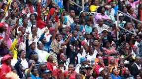 Thousands packed into Zimbabawe's national stadium in Harare to see the inauguration.